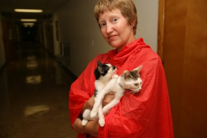 Coffeyville, KS, July 17, 2007 - Kim Veitch, a Humane Society volunteer holds two cats rescued in recent flood and oil spill. FEMA partners with volunteer organizations to assist in disasters. Pet and animal care are part of the efforts FEMA assists in coordinating. Leif Skoogfors/FEMA